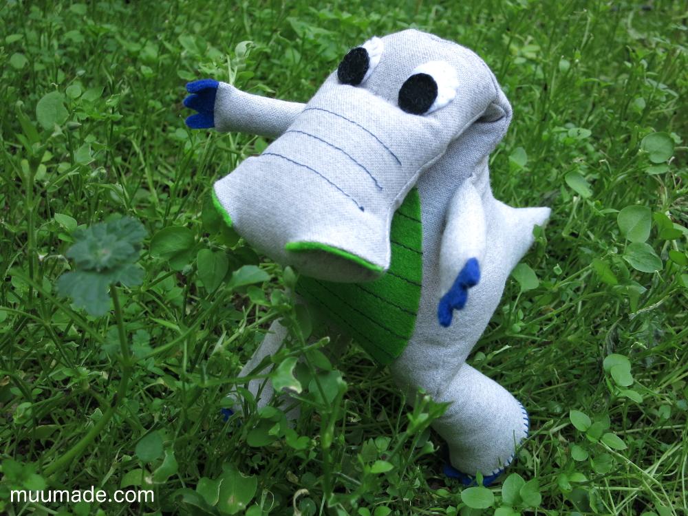 Dinosaur strolling through the grass