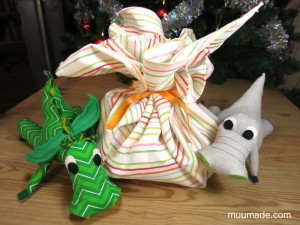 Fabric gift wrap - the wrap bunched and tied with a ribbon at the center