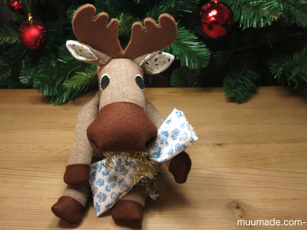 Fabric gift wrap - a stuffed animal moose hugging a small fabric gift bag