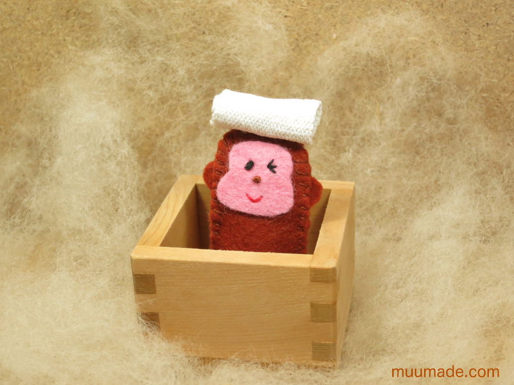 Japanese monkey finger puppet bathing