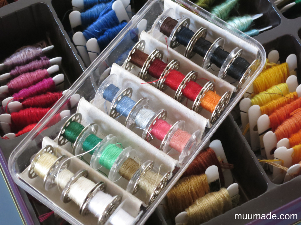 Bobbins and embroidery threads neatly organized