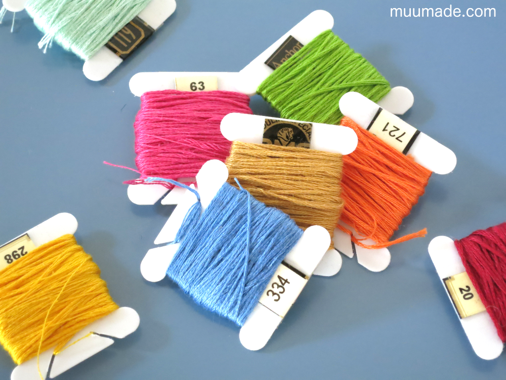 Embroidery threads wound and coded with their color numbers