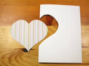 Paper folded in half with a cut out of a heart