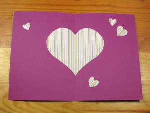 Paper cut out card with hearts