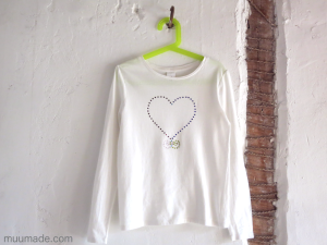 A white T-shirt with a DIY rhinestone design
