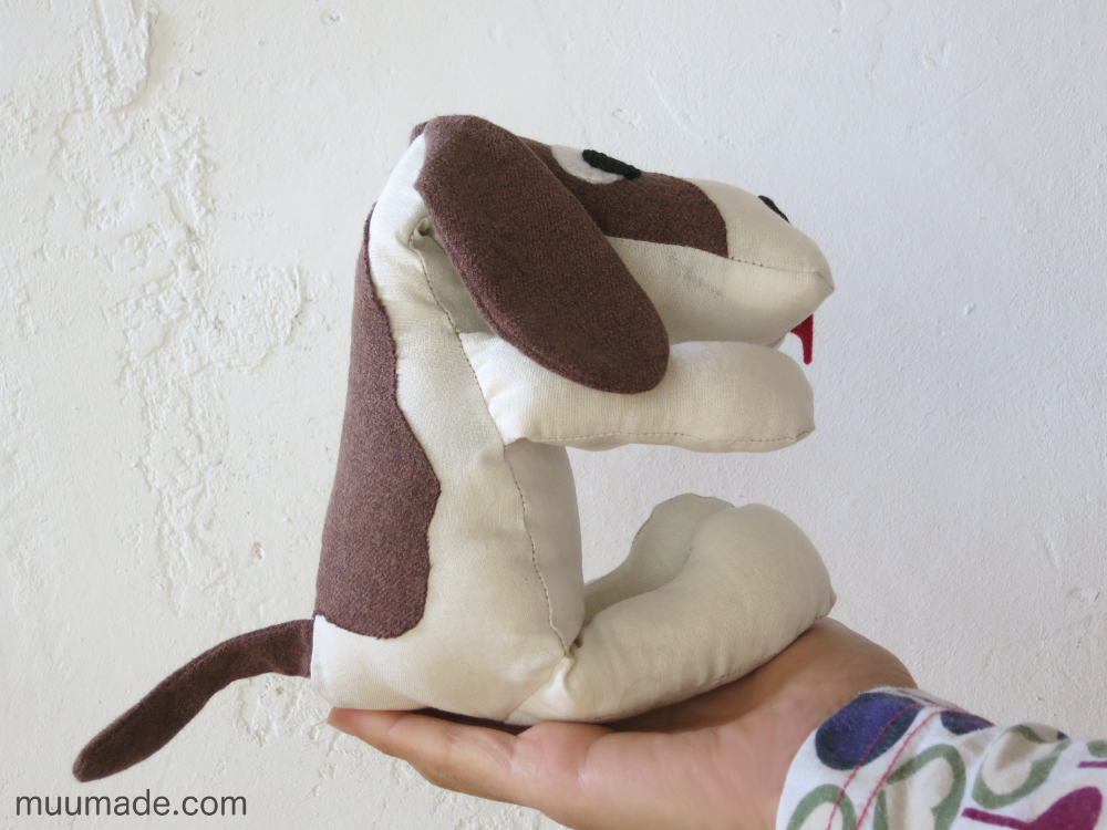 Huggable Doggy , a Beagle stuffed animal sitting on the palm of a hand