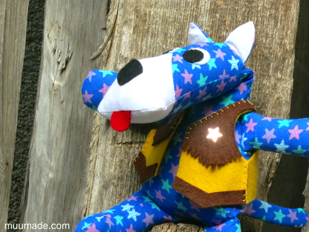 Huggable Doggy stuffed animal wearing a cowboy vest