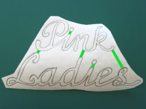 Cutting out detailed designs from felt - Grease Pink Ladies